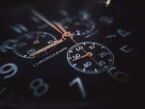 selective-focus photography of black chronograph watch at 9:00